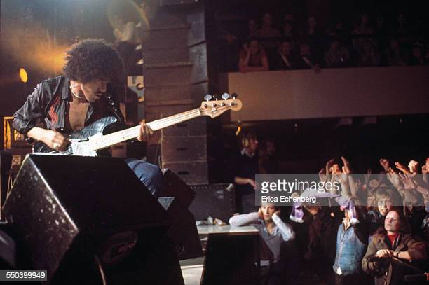 Phil Lynott of Thin Lizzy performs on stage to the front rows of the audience Leeds United Kingdom December 1976