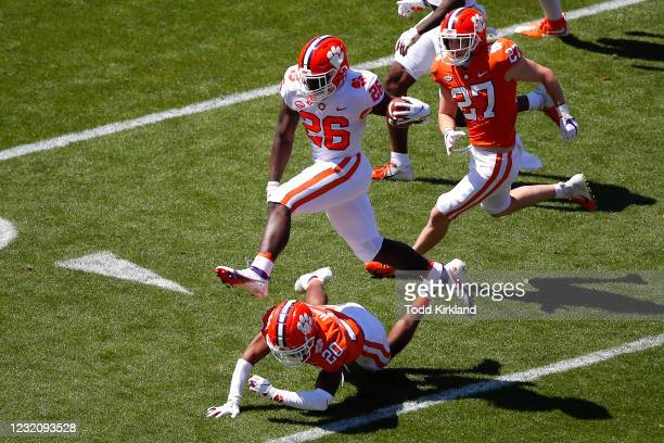 Phil Maffa of the Clemson Tigers leaps over defender, Nate Wiggins during the second half of the Clemson Orange and White Spring Game at Memorial...