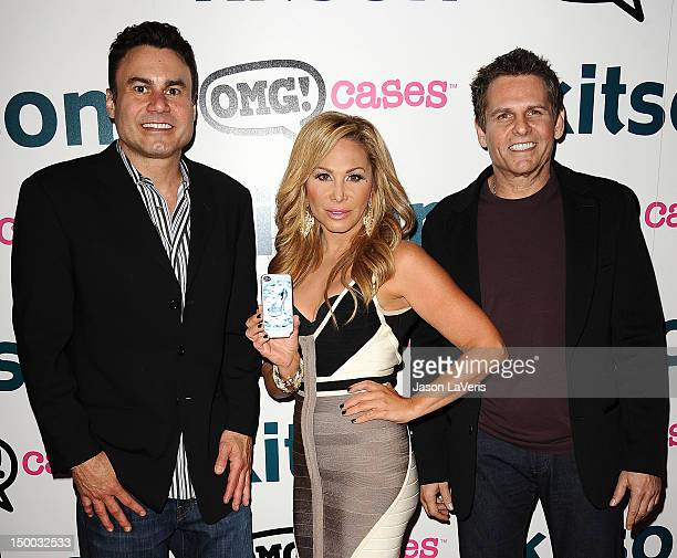 """Phil Maloof, Adrienne Maloof and Joe Maloof attend the launch party for """"OMG Cases"""" at Kitson on Roberston on August 8, 2012 in Beverly Hills,..."""