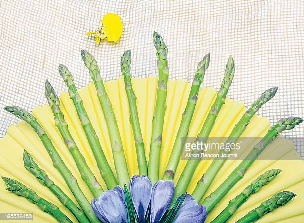 Phil Masturzo color photo illustration of arrangement of asparagus spears and crocus flowers