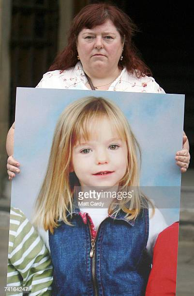 Phil McCann carries a picture of her missing niece Madeleine McCann as she visits Parliament on May 16 2007 in London Madeleine McCann disappeared...