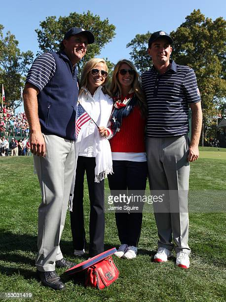 Phil Mickelson Amy Mickelson Jillian Stacey and Keegan Bradley pose on the 12th green during day two of the Morning Foursome Matches for The 39th...