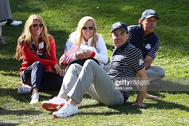 Phil Mickelson Amy Mickelson Jillian Stacey and Keegan Bradley watch the play during day two of the Morning Foursome Matches for The 39th Ryder Cup...