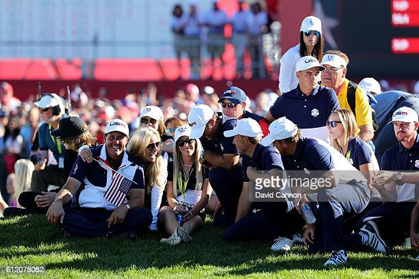 Phil Mickelson Amy Mickelson Justine Reed Patrick Reed and Jordan Spieth of the United States look on during singles matches of the 2016 Ryder Cup at...