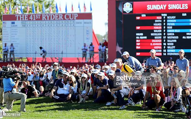 Phil Mickelson Amy Mickelson Justine Reed Patrick Reed Jordan Spieth JB Holmes and Jimmy Walker of the United States look on during singles matches...