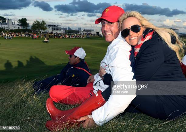Phil Mickelson and Amy Mickelson pose for a photo on the 17th hole during the afternoon fourball matches at the Presidents Cup at Liberty National...