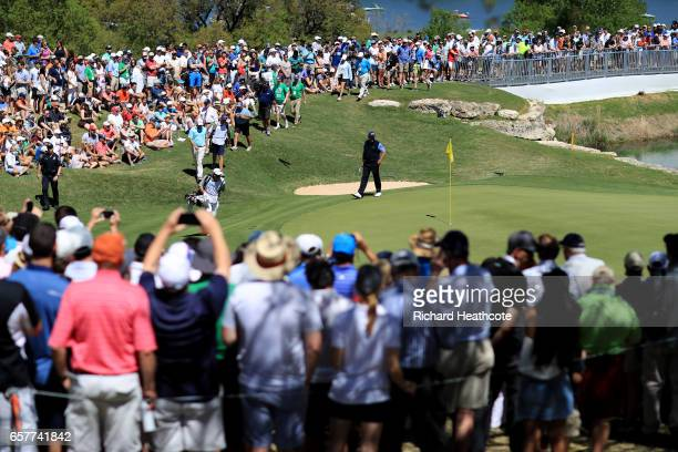 Phil Mickelson and Bill Haas walk on the 11th hole of their match during round five of the World Golf ChampionshipsDell Technologies Match Play at...
