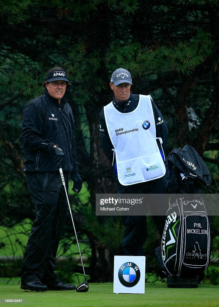Phil Mickelson (L) and caddie Jim 'Bones' Mackay discuss a shot on the fourth tee during the Final Round of the BMW Championship at Conway Farms Golf Club on September 15, 2013 in Lake Forest, Illinois.