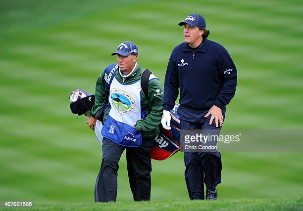Phil Mickelson and caddie Jim 'Bones' MacKay walk to the 6th green during the second round of the ATT Pebble Beach National ProAm at Pebble Beach...
