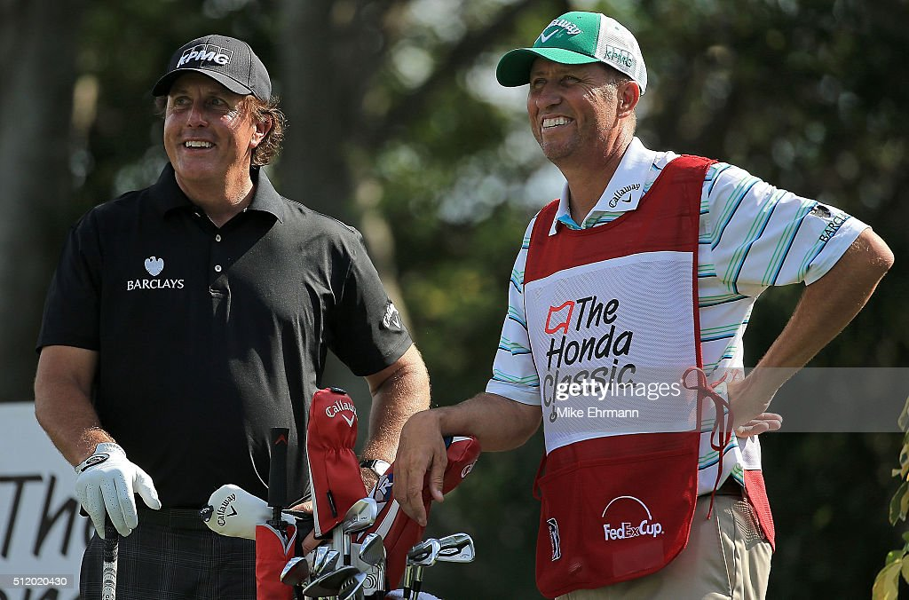 Phil Mickelson and caddie Jim Mackay talk on the 13th hole during the Pro-Am of the 2016 Honda Classic held on the PGA National Course at the PGA National Spa and Resort on February 24, 2016 in Palm Beach Gardens, Florida.