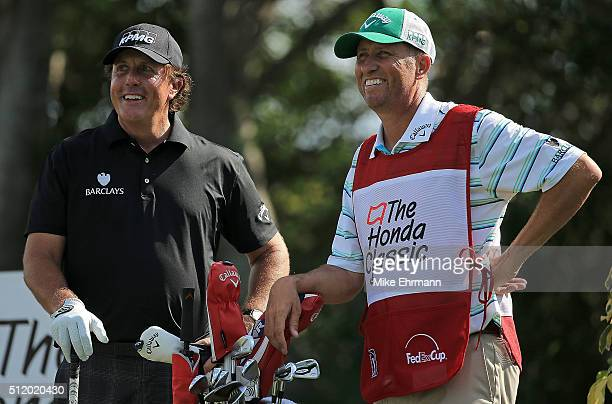 Phil Mickelson and caddie Jim Mackay talk on the 13th hole during the ProAm of the 2016 Honda Classic held on the PGA National Course at the PGA...