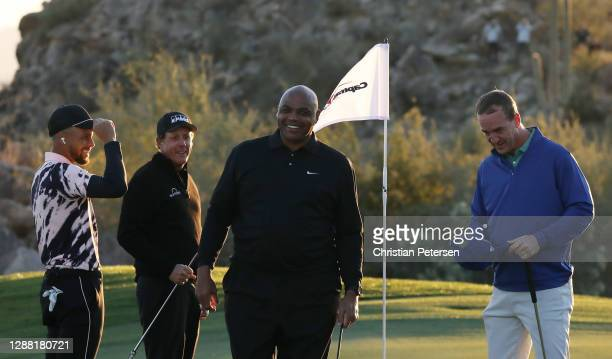 Phil Mickelson and Charles Barkley celebrate defeating Stephen Curry and Peyton Manning 4&3 on the 15th green during Capital One's The Match:...