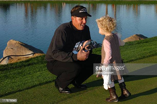 Phil Mickelson and daughter together on the 18th green.during the final round of the 45th Annual Bob Hope Chrysler Classic at PGA West Arnold Palmer...