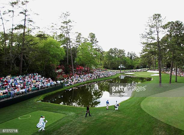 Phil Mickelson and Ernie Els of South Africa walk on the 16th hole during the first round of The Masters at the Augusta National Golf Club on April 6...