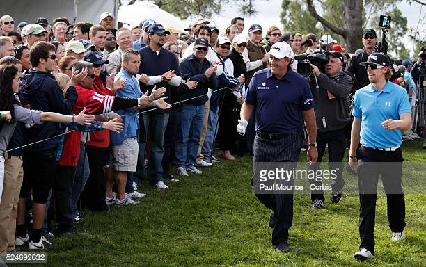Phil Mickelson and Hunter Mahan during the Farmers Insurance Open held at Torrey Pines Golf Course