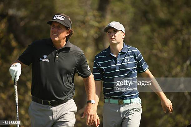 Phil Mickelson and Jordan Spieth walk up the fairway during Round Two of the Valero Texas Open at TPC San Antonio ATT Oak Course on March 28 2014 in...