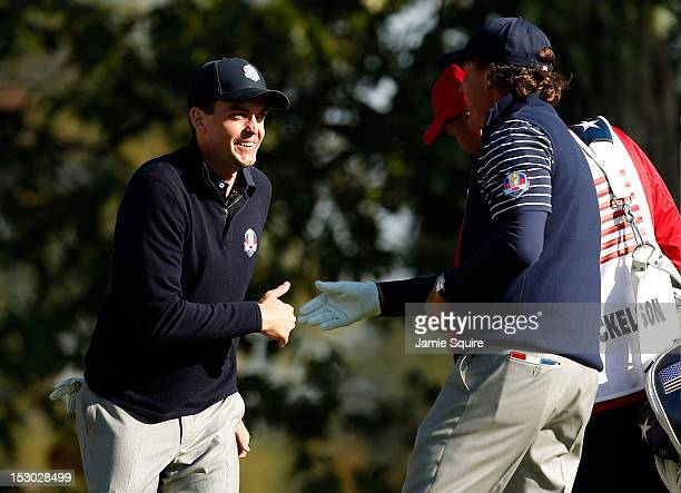 Phil Mickelson and Keegan Bradley celebrate a birdie putt on the seventh green during day two of the Morning Foursome Matches for The 39th Ryder Cup...