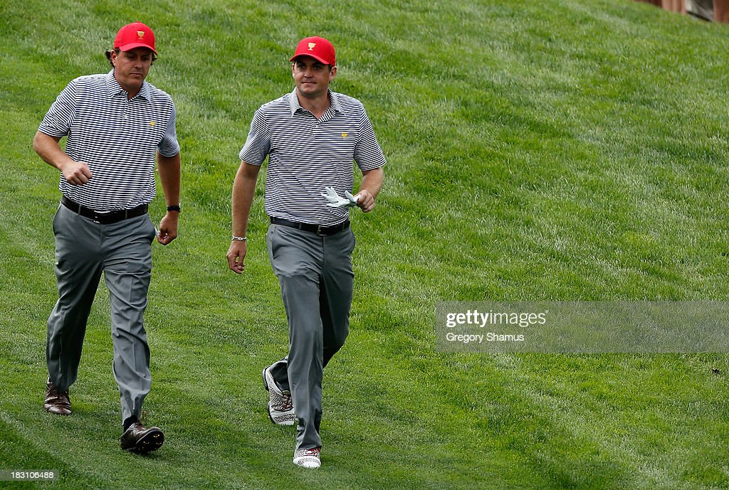 Phil Mickelson (L) and Keegan Bradley of the United States of the U.S. Team walk off a tee box during the Day Two Foursome Matches at the Muirfield Village Golf Club on October 4, 2013 in Dublin, Ohio.