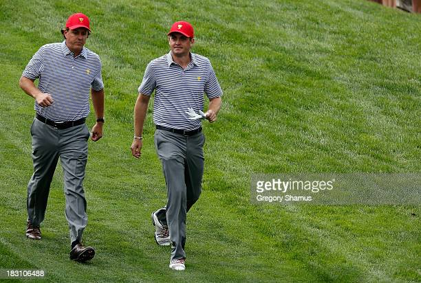 Phil Mickelson and Keegan Bradley of the United States of the US Team walk off a tee box during the Day Two Foursome Matches at the Muirfield Village...