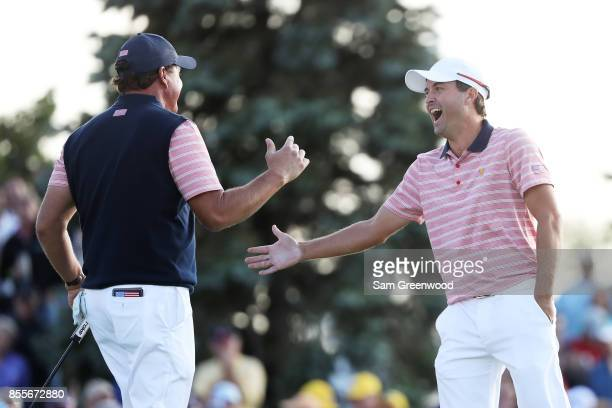 Phil Mickelson and Kevin Kisner of the US Team celebrate on the 18th green after defeating Marc Leishman and Jason Day of Australia and the...