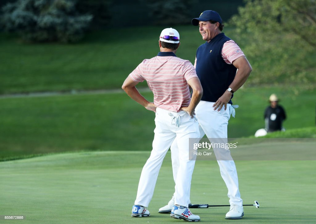 Phil Mickelson and Kevin Kisner of the U.S. Team celebrate on the 18th green after defeating Marc Leishman and Jason Day of Australia and the International Team one up during Friday four-ball matches of the Presidents Cup at Liberty National Golf Club on September 29, 2017 in Jersey City, New Jersey.