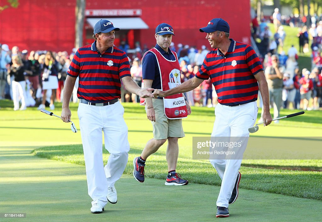 Phil Mickelson and Matt Kuchar of the United States reacts after a putt by Kuchar on the 13th green during afternoon fourball matches of the 2016 Ryder Cup at Hazeltine National Golf Club on October 1, 2016 in Chaska, Minnesota.