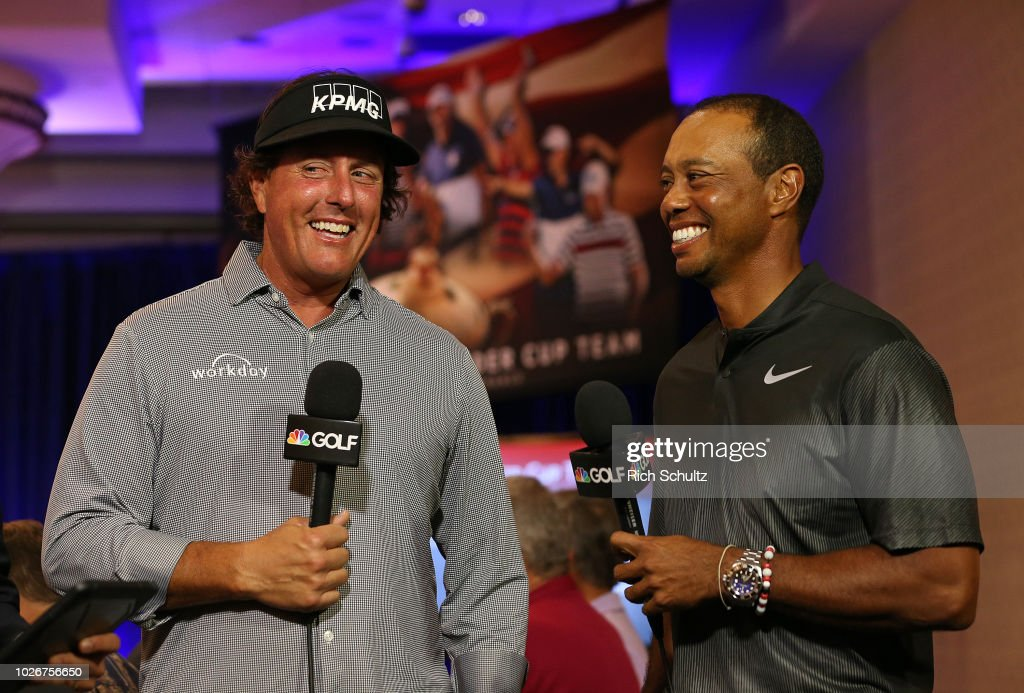 Phil Mickelson and Tiger Woods are interviewed by the Golf Channel after being named as Captain's Picks along with Bryson DeChambeau by U.S. Ryder Cup Captain for the 2018 U.S. team during a press conference at the Philadelphia Marriott West on September 4, 2018 in West Conshohocken, Pennsylvania.