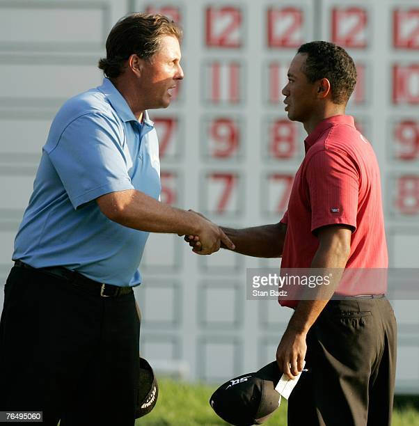 Phil Mickelson and Tiger Woods handshake at the 18th green after the fourth round of the Deutsche Bank Championship, the second event of the new PGA...