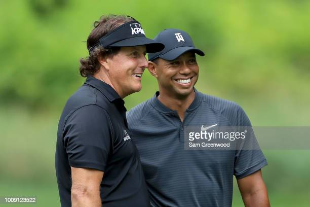 Phil Mickelson and Tiger Woods smile during a practice round prior to the World Golf ChampionshipsBridgestone Invitational at Firestone Country Club...