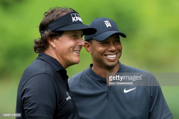 Phil Mickelson and Tiger Woods smile during a practice round prior to the World Golf Championships-Bridgestone Invitational at Firestone Country Club...