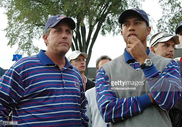 Phil Mickelson and Tiger Woods wait for play during the afternoon foursome competition at the 2004 Ryder Cup in Detroit Michigan September 17 2004