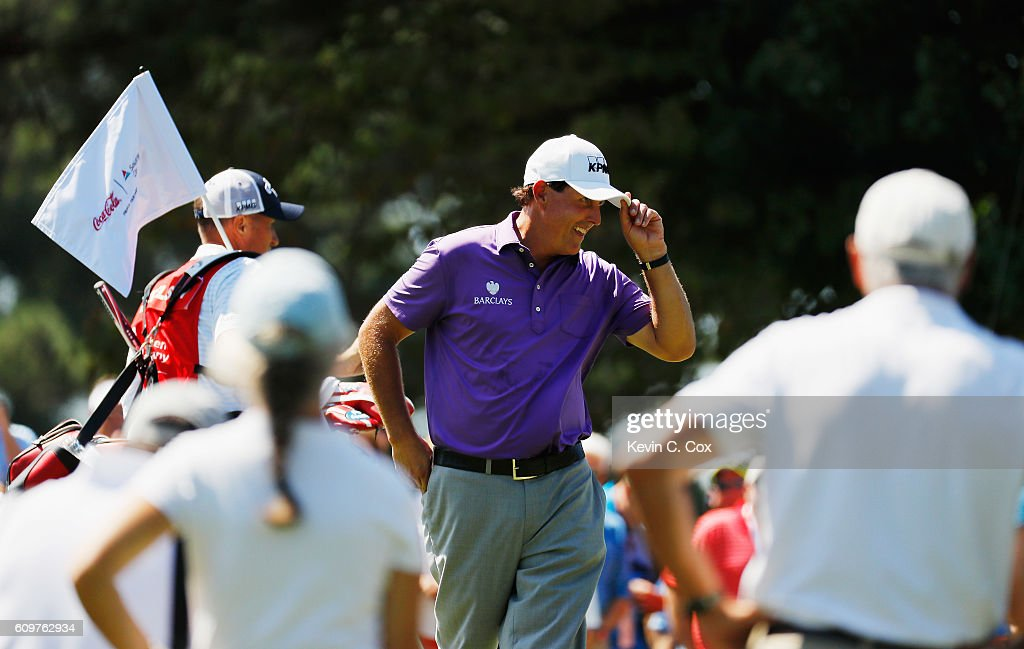 Phil Mickelson celebrates after a long birdie putt on the first hole during the first round of the TOUR Championship By Coca-Cola at East Lake Golf Club on September 22, 2016 in Atlanta, Georgia.