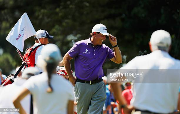 Phil Mickelson celebrates after a long birdie putt on the first hole during the first round of the TOUR Championship By CocaCola at East Lake Golf...