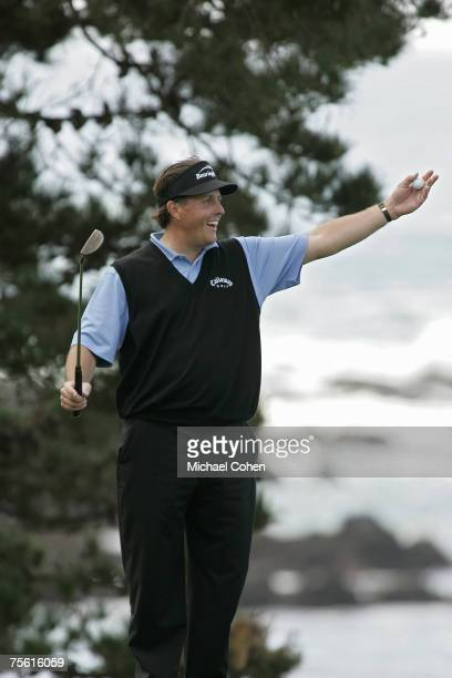 Phil Mickelson celebrates his amateur partner's shot on the fifth hole during the fourth round of the AT&T Pebble Beach National Pro-Am on the Pebble...