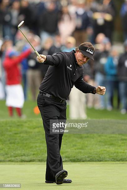 Phil Mickelson celebrates his parsaving putt on the 15th hole during the final round of the ATT Pebble Beach National ProAm at Pebble Beach Golf...