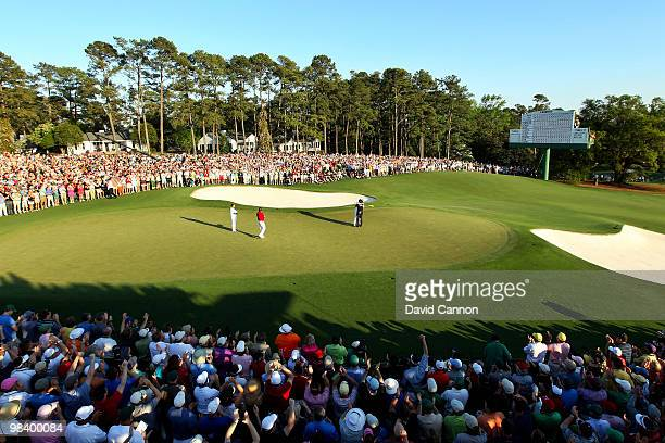 Phil Mickelson celebrates his threestroke victory as Lee Westwood of England looks on during the 2010 Masters Tournament at Augusta National Golf...