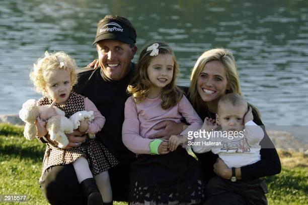Phil Mickelson celebrates his win as he poses for a portrait with his wife Amy and their three children twoyear old Sophia Isabel fouryear old Amanda...