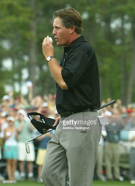 Phil Mickelson celebrates kissing his ball after his birdie to win the Masters by one shot on the 18th green during the final round of the Masters at...