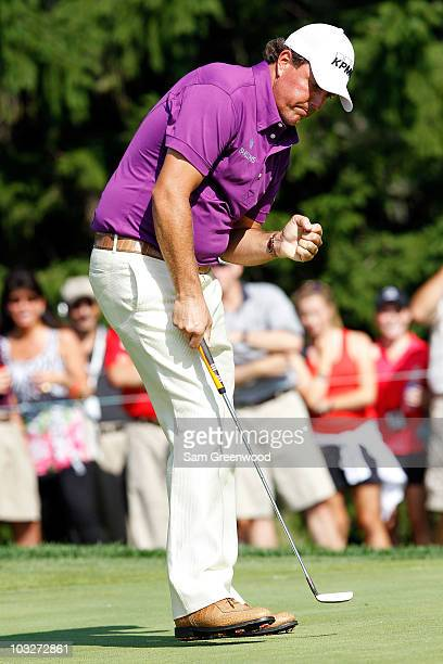 Phil Mickelson celebrates making birdie on the 15th hole during the second round of the World Golf Championships - Bridgestone Invitational on the...