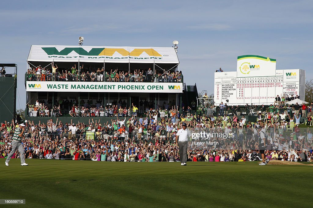 Phil Mickelson celebrates making his birdie putt on the 18th hole during the third round of the Waste Management Phoenix Open at TPC Scottsdale on February 2, 2013 in Scottsdale, Arizona.