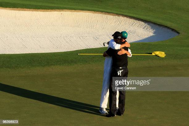 Phil Mickelson celebrates with his caddie Jim Mackay after his threestroke victory after winning the 2010 Masters Tournament at Augusta National Golf...