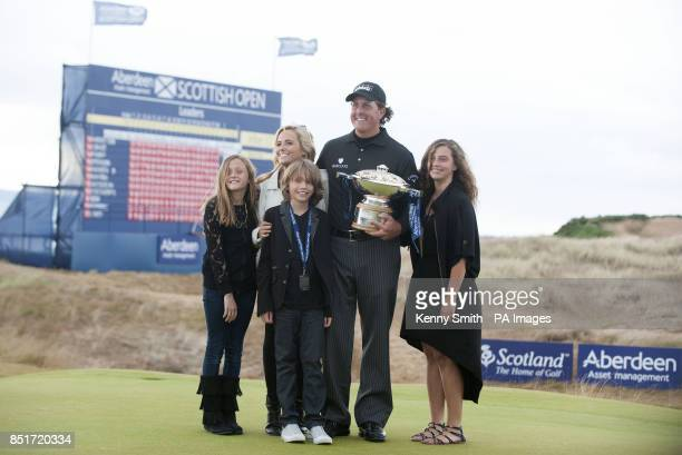 Phil Mickelson celebrates with his wife Amy and children after winning the Aberdeen Asset Management Scottish Open at Castle Stuart Golf Course...