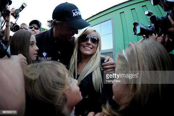 Phil Mickelson celebrates with his wife Amy and children Amanda Evan and Sophia after his threestroke victory after winning the 2010 Masters...