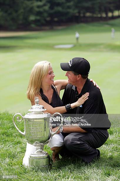 Phil Mickelson celebrates with his wife, Amy, next to the Wanamaker Trophy after he won the 87th PGA Championship at Baltusrol Golf Club in...