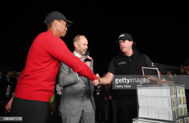 Phil Mickelson celebrates with the winnings after defeating Tiger Woods as Ernie Johnson looks on during The Match Tiger vs Phil at Shadow Creek Golf...