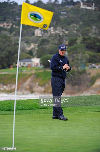 Phil Mickelson checks his putting line on the 6th green during the second round of the ATT Pebble Beach National ProAm at Pebble Beach Golf Links on...