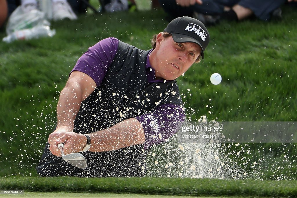 Phil Mickelson chips from the bunker onto the ninth green during the second round of the Waste Management Phoenix Open at TPC Scottsdale on February 3, 2017 in Scottsdale, Arizona.