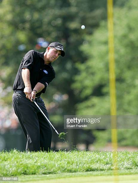Phil Mickelson chips onto the 18th green during the completion of the final round of the 2005 PGA Championship on August 15, 2005 in Springfield, New...
