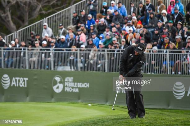 Phil Mickelson chips onto the fifteenth hole green during the final round of the AT&T Pebble Beach Pro-Am at Pebble Beach Golf Links, on February 10,...
