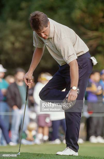 Phil Mickelson cleans his cleats while competing in the 1993 PGA The Tour Championship played October 2831 1993 at The Olympic Club in San Francisco...